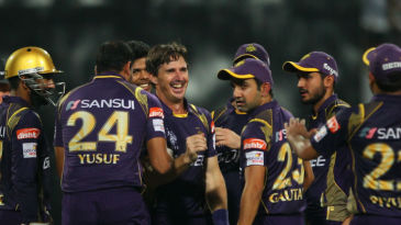 Brad Hogg is mobbed by his team-mates