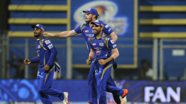 Rohit Sharma, Mitchell McClenaghan and Ambati Rayudu celebrate a wicket