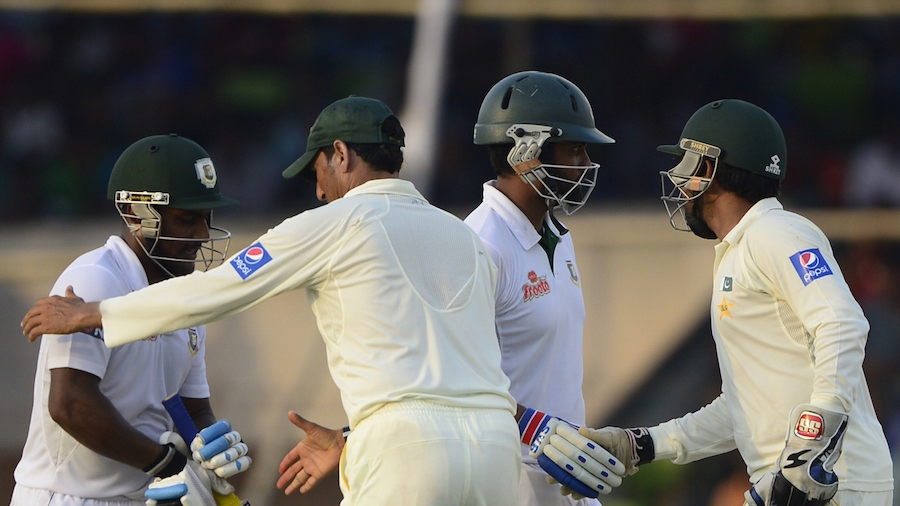 The Pakistan players congratulate Tamim Iqbal and Imrul Kayes at the end of the day