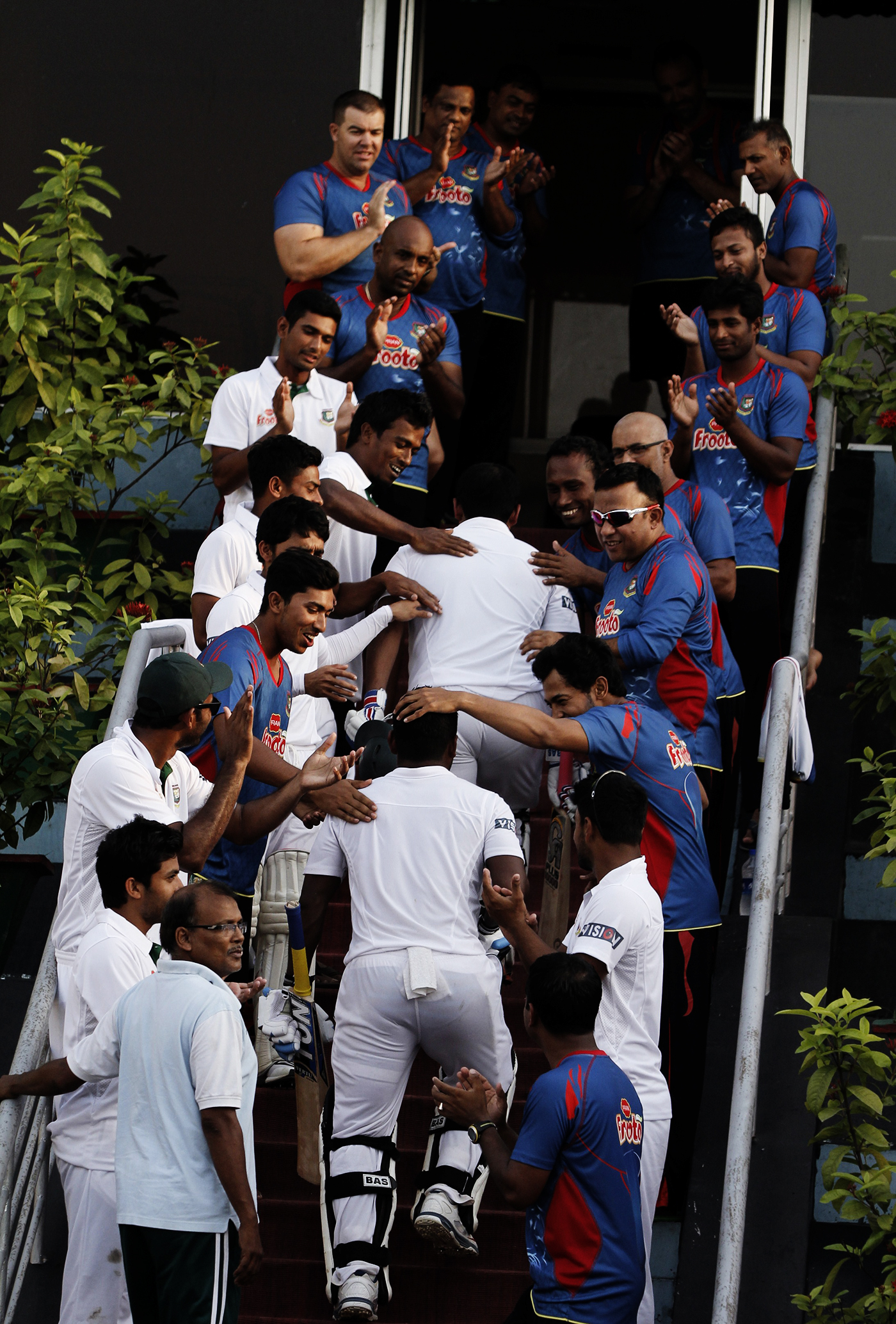 Players congratulate Imrul Kayes and Tamim for their record opening partnership in Khulna against Pakistan in 2015