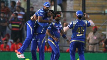 Harbhajan Singh celebrates a wicket with his team-mates