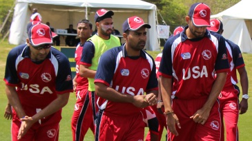 Muhammad Ghous (second from l-r) leads USA onto the field