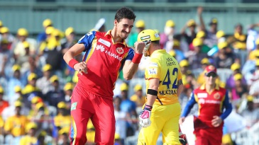 Mitchell Starc exults after bowling Dwayne Smith for a duck