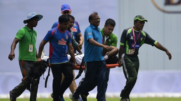 Shahadat Hossain is stretchered off the field