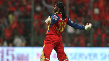 Chris Gayle roars after reaching his 14th Twenty20 century