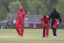 Ruvindu Gunasekera raises his bat upon reaching 50, Bermuda v Canada, ICC Americas Regional T20, Indianapolis, May 4, 2015