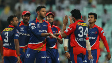 Yuvraj Singh celebrates a wicket with his team-mates