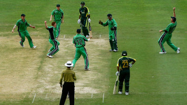 Kevin O'Brien celebrates with his team-mates after taking the wicket of Shoaib Malik