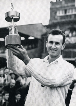 Ted Dexter lifts the Gillette Cup after Sussex's victory in the first one-day final
