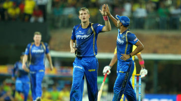 Chris Morris celebrates a wicket with Stuart Binny