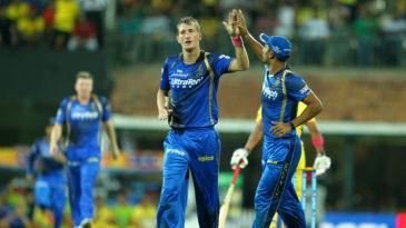 Chris Morris celebrates a wicket with Stuart Binny