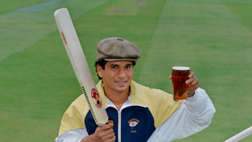 Sachin Tendulkar holds aloft a glass of beer