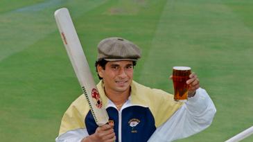 Sachin Tendulkar holds aloft a glass of beer