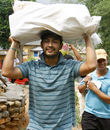 Subash Khakurel, wicket keeper batsman of the Nepal national cricket team carrying relief material to earthquake victims at Baseshwor VDC in Sindhuli on May 7 2015.