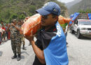 Gyanendra Malla, Vice-Captain of the Nepal national cricket team carrying a sack of rice to be distributed to earthquake victims at Baseshwor VDC in Sindhuli on May 7 2015