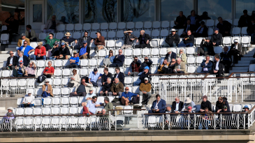 Surrey members watch from the pavilion