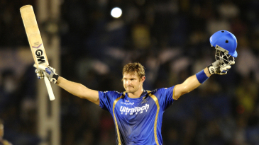 Shane Watson celebrates after scoring his second T20 century