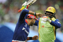Yuvraj Singh and Chris Gayle share a light moment as the teams leave the field, Royal Challengers Bangalore v Delhi Daredevils, IPL 2015, Bangalore, May 17, 2015