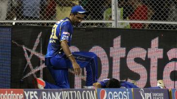 Barinder Sran looks back after colliding with Deepak Hooda