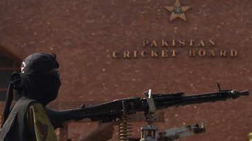 A Pakistani ranger sets up a position outside the Gaddafi Stadium