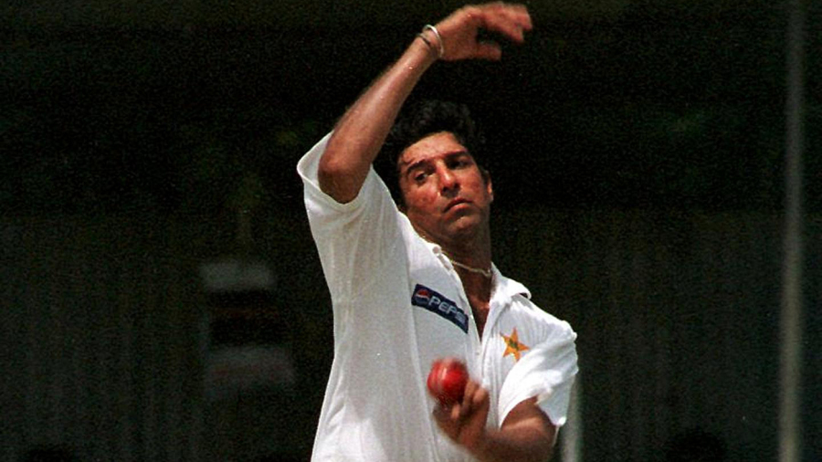 Wasim Akram runs in to bowl
