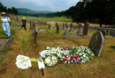 Flowers are placed on the grave of Fred Trueman at Bolton Abbey, England, July 6, 2006