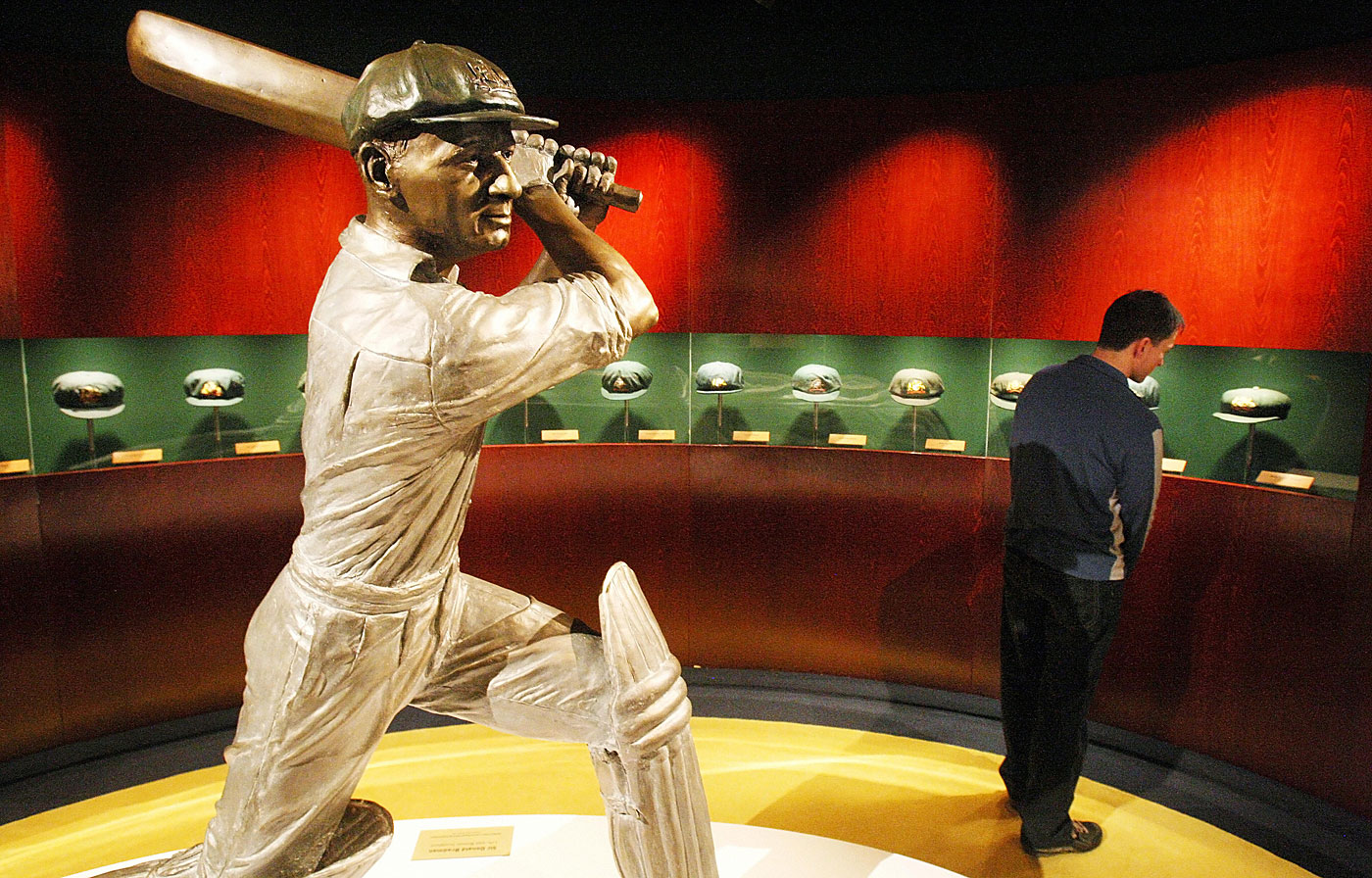 A statue of Don Bradman takes pride of place amid a display of his baggy green caps at the MCG's National Sports Museum