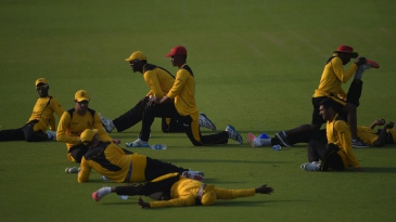 The Zimbabwe players stretch before a net session