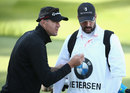 Kevin Pietersen autographs his caddie's bib, Wentworth, England, May 20, 2015