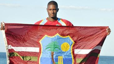 Jason Holder holds the West Indies flag
