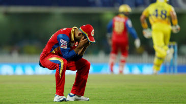 Virat Kohli reacts after a dropped catch