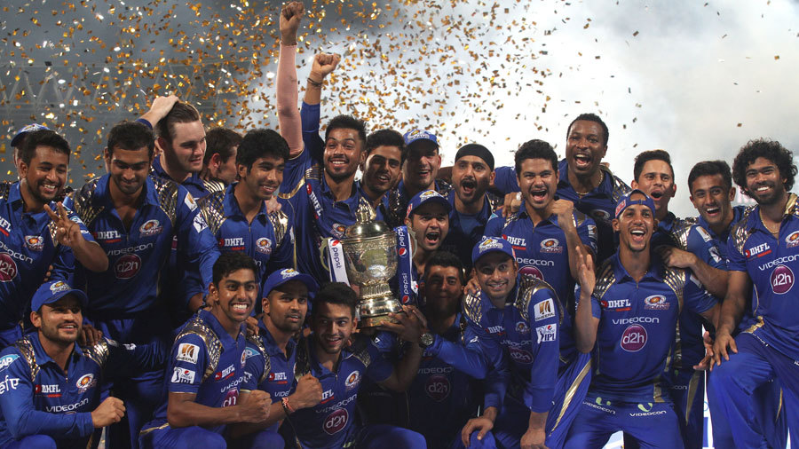 Mumbai Indians celebrate with the IPL 2015 trophy