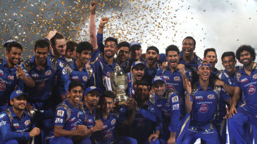 Mumbai Indians celebrate with the IPL 2015 trophy