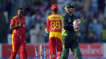 Mohammad Hafeez walks back after being dismissed by Prosper Utseya