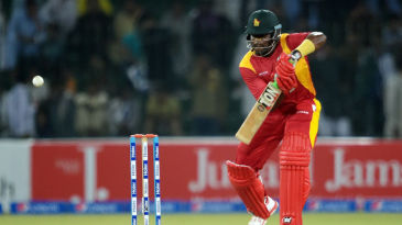 Hamilton Masakadza punches through the off side