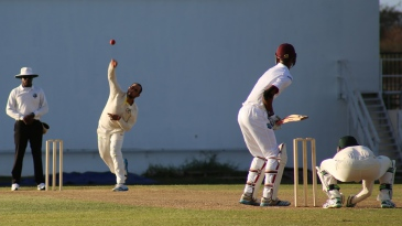 Fawad Ahmed sends down a delivery to Roston Chase