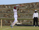 Roston Chase punches off the back foot during his half-century,  WICB President's XI v Australians, Antigua, 3rd day, May 29, 2015