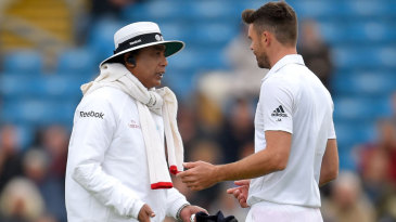 Umpire S Ravi talks to James Anderson about running on the pitch