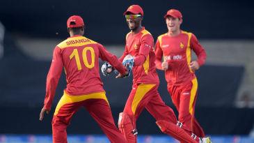 Richmond Mutumbami and Vusi Sibanda celebrate a wicket
