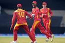 Richmond Mutumbami and Vusi Sibanda celebrate a wicket, Pakistan v Zimbabwe, 3rd ODI, Lahore, May 31, 2015