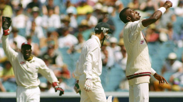 Curtly Ambrose punches the air as he celebrates a wicket