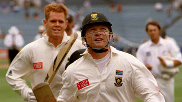 Daryll Cullinan and Shaun Pollock leave the field