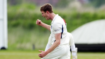 Alasdair Evans exults after picking up a wicket