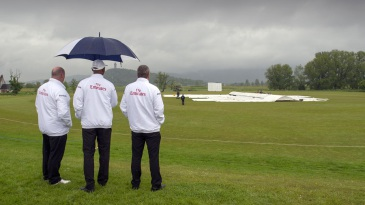 The umpires wait for wet weather to clear in Stirling