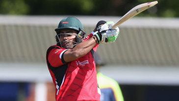 Umar Akmal gets on his tip-toes to cut