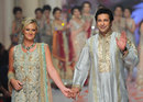 Wasim Akram with his wife Shaniera at the Bridal Couture Fashion Week in Karachi, Karachi, June 8, 2015