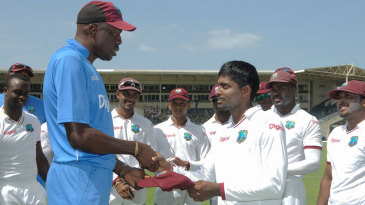 Rajendra Chandrika receives his Test cap from Curtly Ambrose