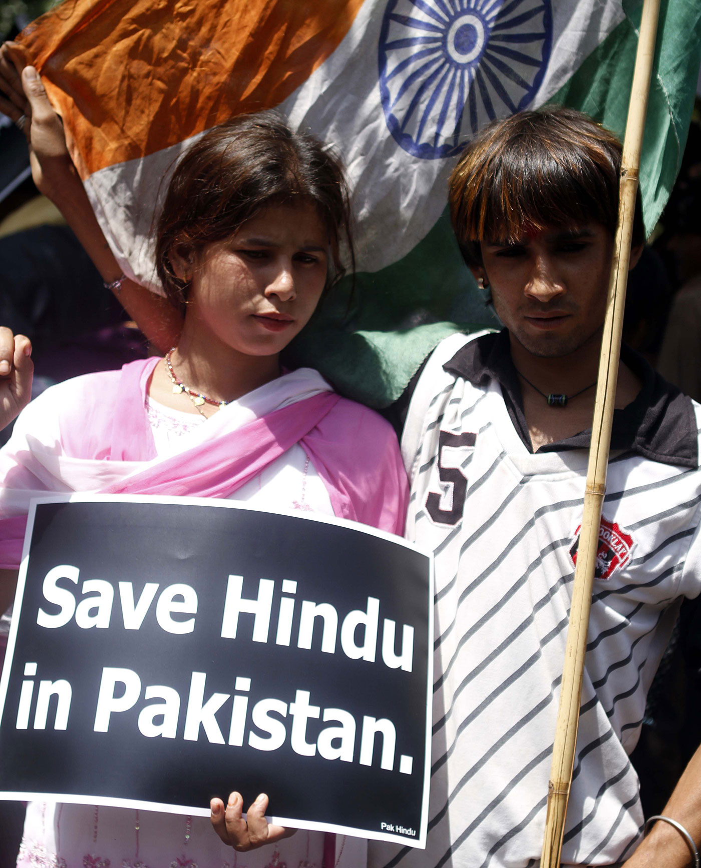 Minority report: Hindus from Pakistan gather outside the UN Information Centre in New Delhi, demanding they be allowed to stay in India