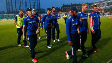 The England players walk off after their 13-run loss