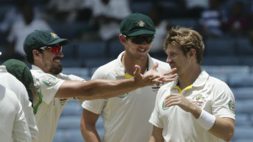 Mitchell Starc and Shane Watson share a lighter moment